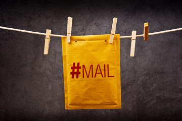 Mail Envelope with hash tag on clothes rope