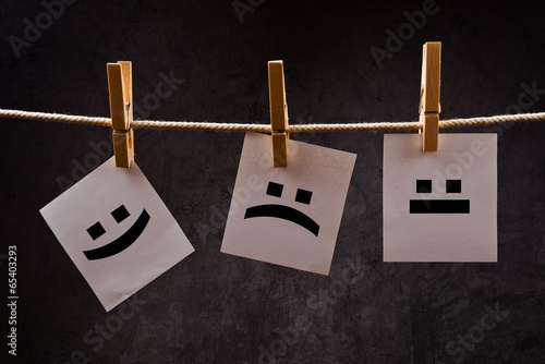 Emoticons on note paper attched to rope with clothes pins Poster