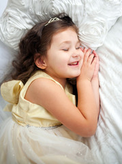Happy smiling kid sleeping