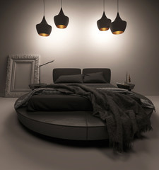 Black bed standing under four ceiling lamps