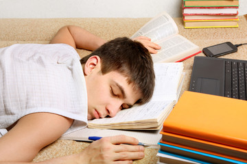 Teenager sleeps on the Books