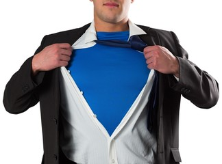 Businessman opening his shirt superhero style