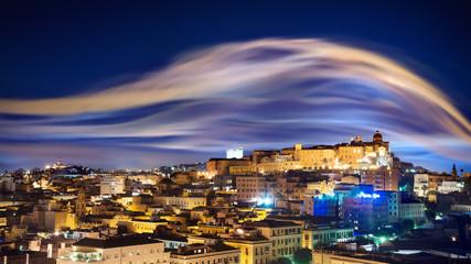 City skyline with smoke illuminated by lights