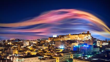 City skyline by night like an aurora borealis