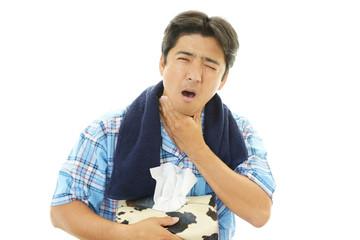 風邪にり患した男性