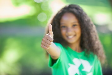 Young environmental activist smiling at the camera showing thumb