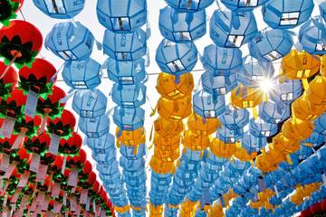 Colorful lanterns with sun rays