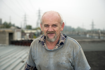 Portrait of aged man in old clothes for dirty works.