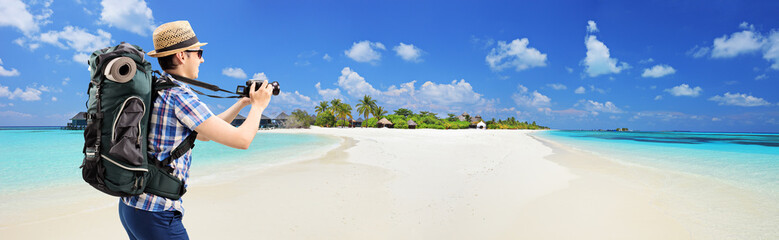 Tourist taking picture of beach at Maldives