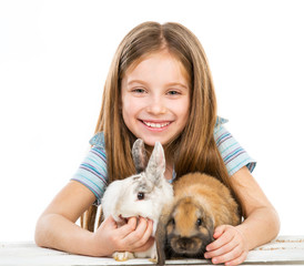 little girl with rabbits