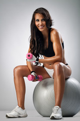 Fit woman with dumbbells