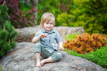Portrait of a pisitive kid in the beautiful garden