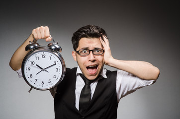Businessman with clock in time concept