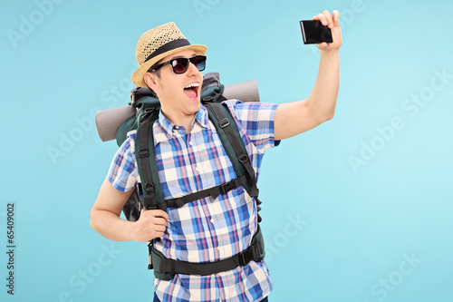 Tourist taking a selfie with cell phone