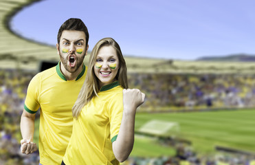 Brazilian couple fan celebrate on the stadium