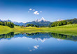 Leinwanddruck Bild - Idyllic summer landscape with mountain lake and Alps