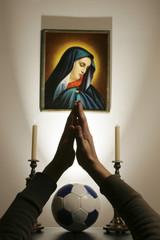Beten für den Sieg des Fußballteams