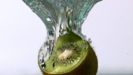 Kiwi half falling into water