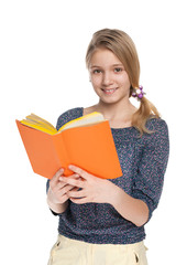 Cheerful girl reads book