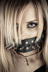 portrait of a slave in BDSM theme gagged of thorns