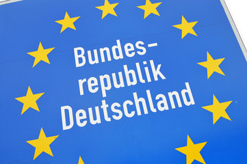 Close-up of a sign at the border of Germany