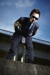 Asian man posing outdoor in suit