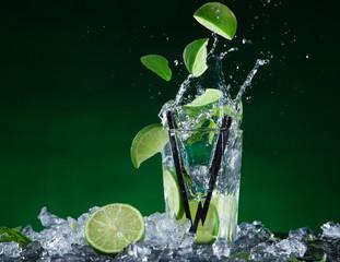 Fresh mojito cocktail in freeze motion splashing