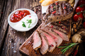 Beef steak on wooden table