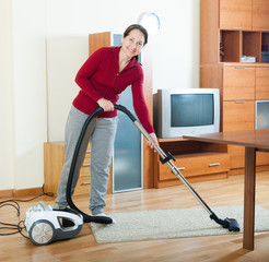 woman cleaning with vacuum cleaner