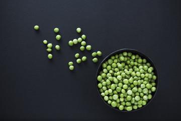 Fresh Green peas on black background