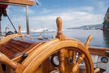Fototapeta Old boat steering wheel from wood