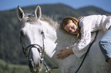 Teenager-Mädchen auf Pferd