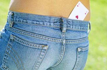 Spielkarte in Jeans-Tasche