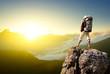 Leinwanddruck Bild - Tourist on rock. Sport and active life concept