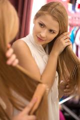 beautiful young girl combing hair.