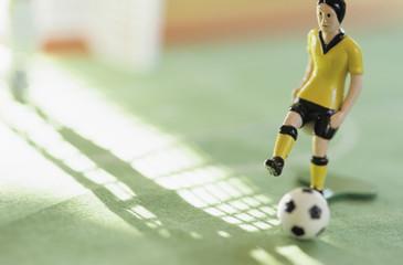 Figur spielt Fußball, Tipp Kick