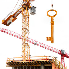 Construction crane with golden key. New home concept.
