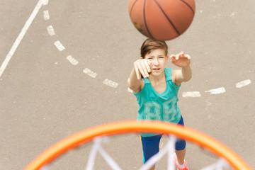 Young teenage girl practicing her basketball