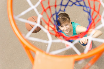 View through the net of a basketball shooter
