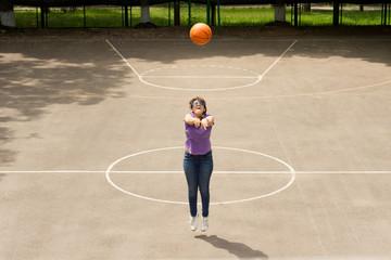 Young girl shooting a basketball