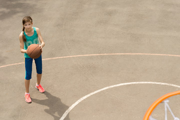 Slim athletic young female basketball player