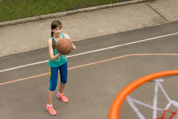 Young girl practising for the basketball team