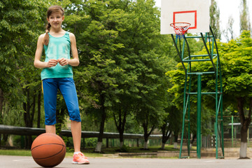 Young girl waiting to play basketball