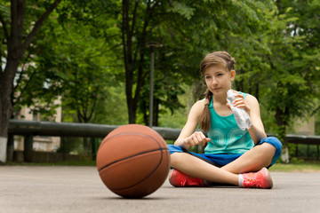 Thoughtful young teenage basketball player