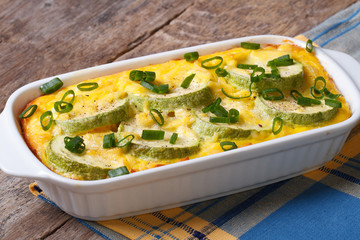 Casserole with zucchini in a white dish close up