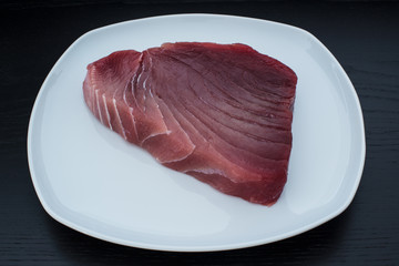 Large fresh and raw yellowfin tuna steak