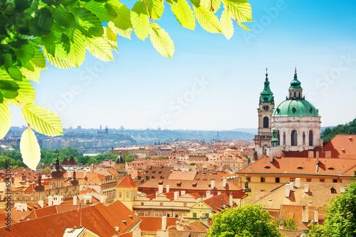 Fototapeta Church of St. Nicholas red tile roofs in Prague