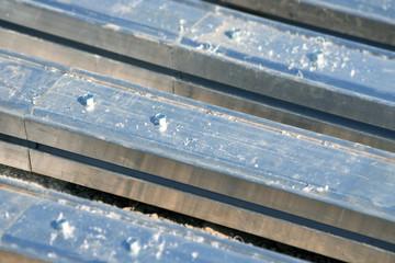Steel nuts on aluminium construction frame