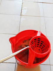 washing the tile floor by mop