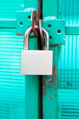 green door locked with steel padlock